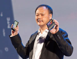 HTC CEO Peter Chou shows the new Desire HD, left, and Desire Z, at their launch in London.