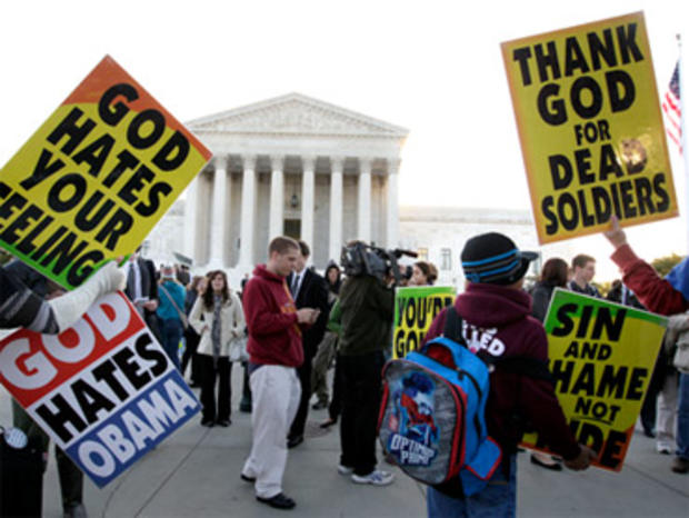 Members of the Westboro Baptist Church picket in front of the Supreme Court