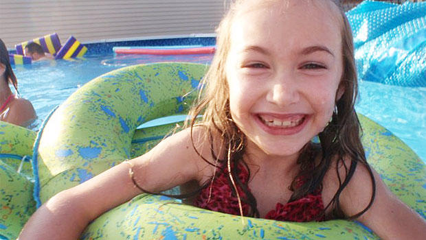 Kathleen Edward, 7, is dying from Huntington's disease and also enduring cyberbullying.