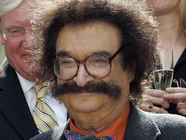 """FILE - In this May 31, 2006 file photo, film critic Gene Shalit is seen during a toast with """"Today"""" show cast and crew at the end of Katie Couric's final show, in New York. Shalit, 85, said Tuesday, Nov. 9, 2010 that he's leaving the """"Today"""" show, where he's reviewed movies for 40 years. (AP Photo/Richard Drew, File)"""