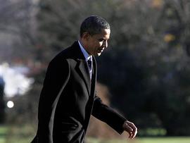President Barack Obama returns to the White House in Washington