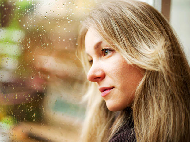 woman, sad, window, seasonal affective disorder, istockphoto, 4x3