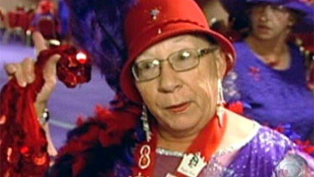 """Roberta Kresleym shows off her """"bling"""" at a recent convention of the Red Hat Society in Laughlin, Nev."""