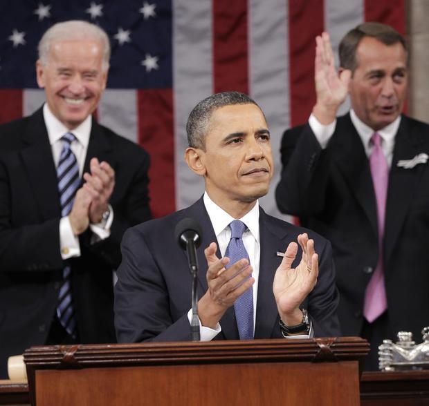 President Barack President Barack Obama is applauded by Vice President Joe Biden and House Speaker John Boehner of Ohio