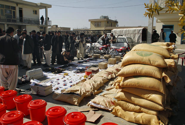 Confiscated Taliban drugs and weapons