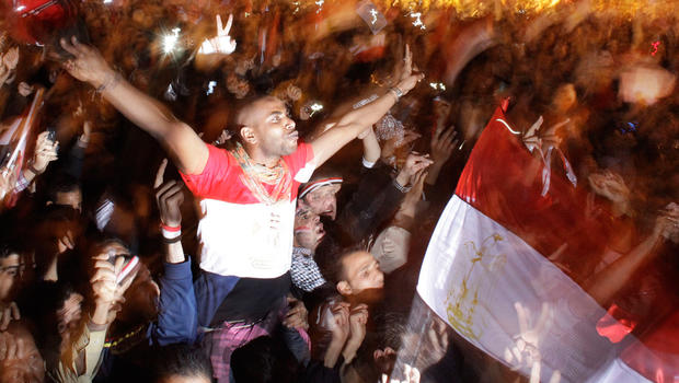 Egyptians celebrate the news of the resignation of President Mubarak