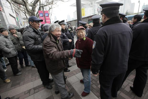 China protesters told to go home