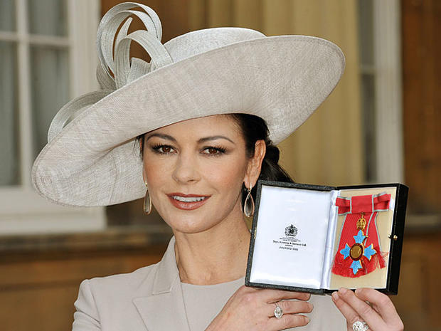 Catherine Zeta-Jones holds herCommander of the Order of the British Empire (CBE) at Buckingham Palace in London, on Feb. 24, 2011.  (STILLWELL/AFP/Getty Images)