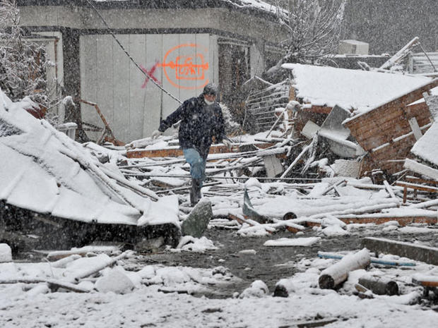 Snow adds to Japan's misery