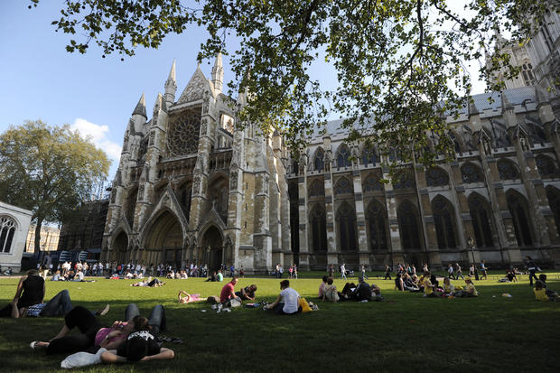 Tourists relax in the gardens outside Westminster Abbey on April 22, 2011, before the royal wedding between Britain's Prince William and his fiancee Kate Middleton at Westminster Abbey on April 29, 2011.