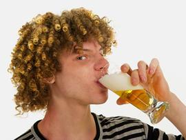 young women binge drinking at bar