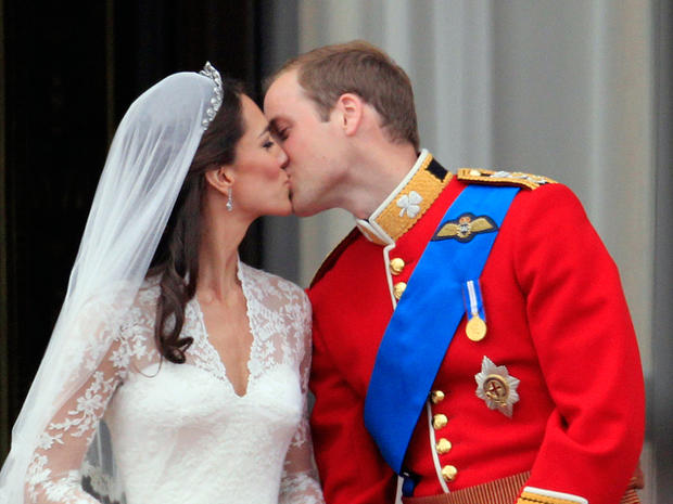 Britain's Prince William kisses his wife Kate, Duchess of Cambridge on the balcony of Buckingham Palace