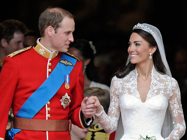 Britain's Prince William and his wife Kate, Duchess of Cambridge stand outside of Westminster Abbey