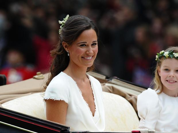 Maid of honour Philippa Middleton smiles as the travels in a Semi-State Landau in London after the wedding service for Britain's Prince William and Kate, Duchess of Cambridge, on April 29, 2011. AFP PHOTO / PAUL ELLIS (Photo credit should read PAUL ELLIS/