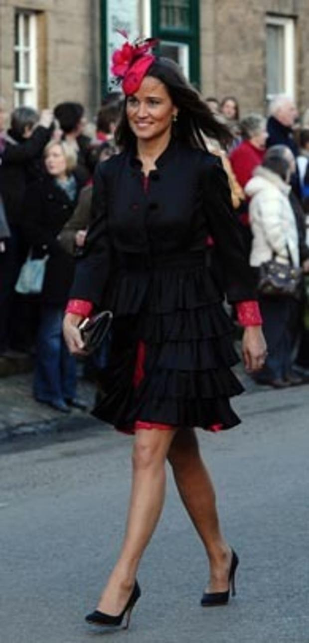 Pippa Middleton, the sister of Kate Middleton, fiancee of Britain's Prince William, arrives for the wedding service of Lady Katie Percy, the eldest daughter of the Duke and Duchess of Northumberland in Alnwick, north-east England, on February 26, 2011. La