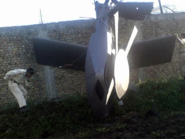 A photo of the damaged U.S. helicopter seen lying near the compound where Osama bin laden was killed and captured.