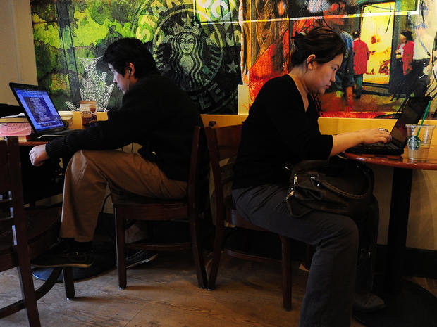 Beijing residents on laptops at a coffee shop