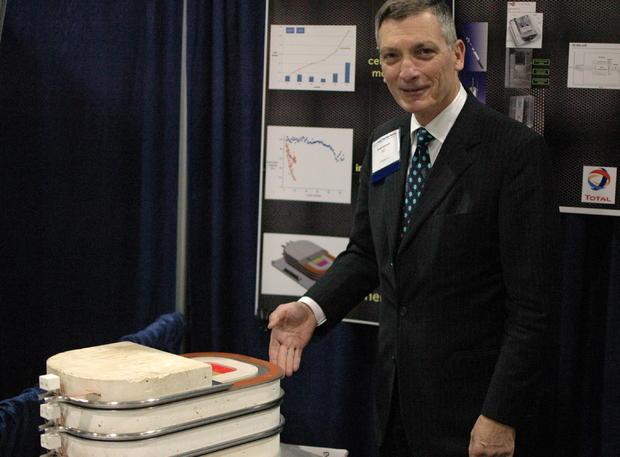 Professor Donald Sadoway shows off a prototype of an all-liquid metal battery under development.