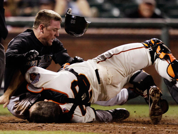 Scott Cousins collides with catcher Buster Posey