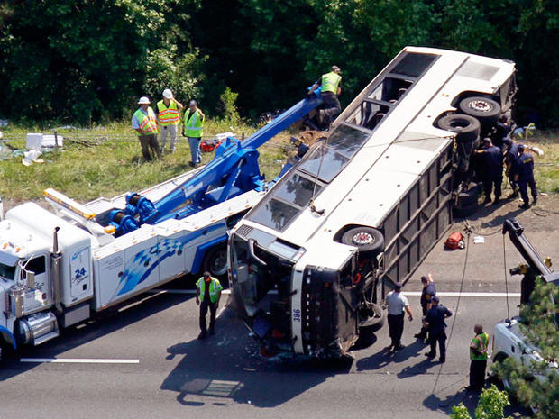 Driver charged in bus crash that killed 4, hurt dozens