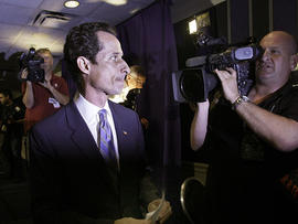 U.S. Congressman Anthony Weiner, D-NY, is pursued by the media as he leaves a news conference in New York, June 6, 2011.