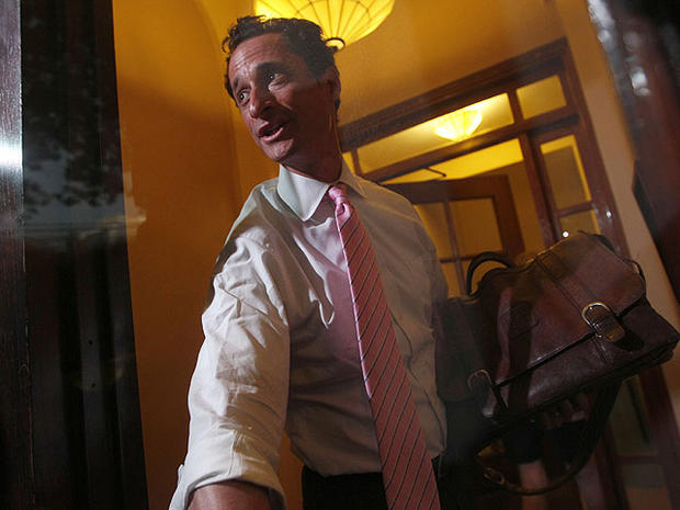 Rep. Anthony Weiner, D-N.Y., closes the front door of his building on reporters as he arrives at his house in the Queens borough of New York, Thursday, June 9, 2011.