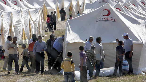 Syrian refugees are seen in a tent compound in Boynuyogun, Turkey, near the Syrian border, June 13, 2011.