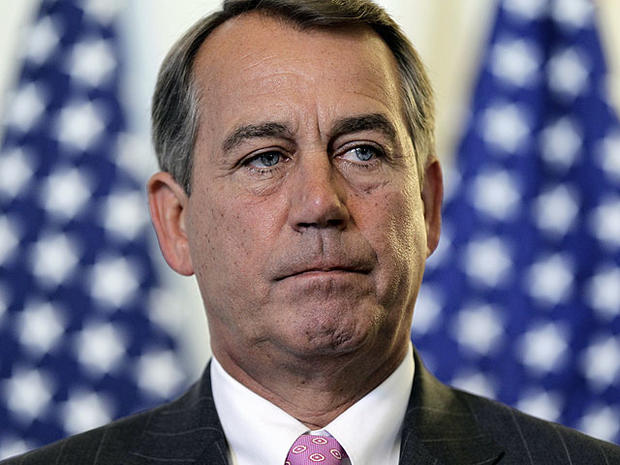 House Speaker John Boehner talks to the press following a political strategy session on Capitol Hill in Washington, June 14, 2011.