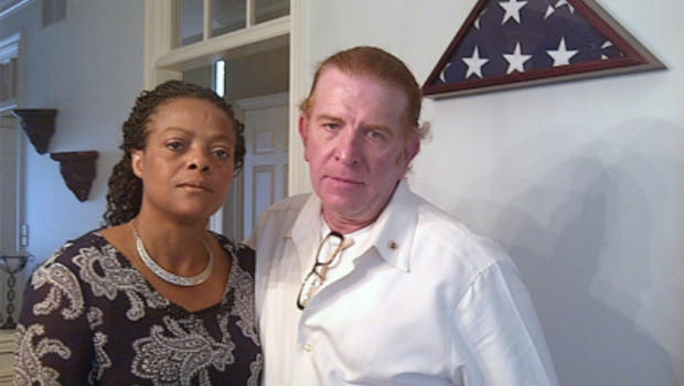 Gregg and Jannett Keesling at their home in Indianapolis. Behind them is an empty spot on a memorial wall for their son, Chance, where they'd planned to display a presidential condolence letter. They haven't received one.