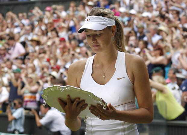 Maria Sharapova looks at her runner-up trophy