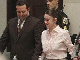 Defense attorney Jose Baez and Casey Anthony react after the jury acquitted her of murdering her daughter, Caylee, during Anthony's murder trial at the Orange County Courthouse in Orlando, Fla., July 5, 2011.
