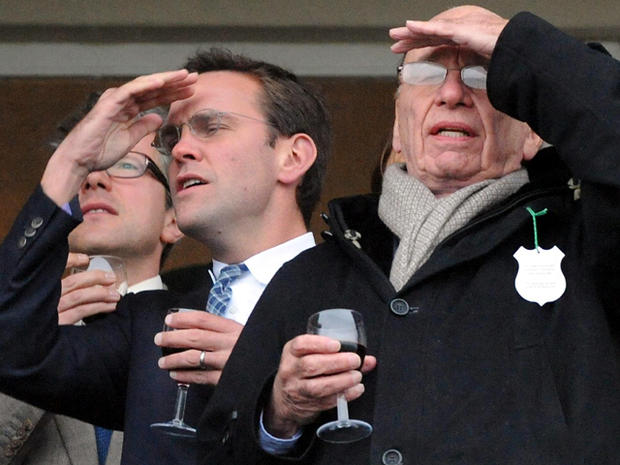 James Murdoch, left, and Rupert Murdoch are seen during the Cheltenham Festival at Cheltenham, England, March 18, 2010.