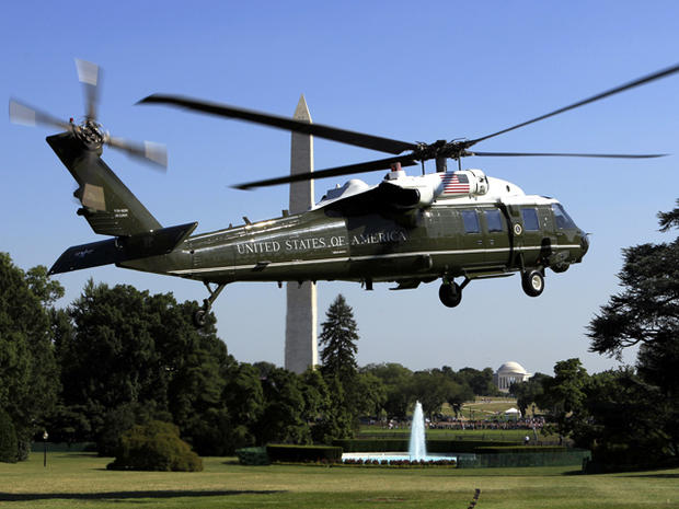 The Marine One helicopter carrying President Obama takes off from the South Lawn of the White House in Washington July 1, 2011, for Camp David, Md. The Washington Monument is at left, and the Jefferson Memorial is at center.