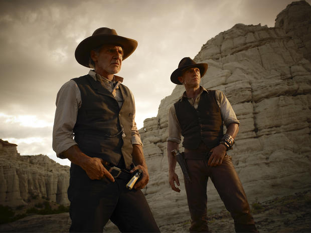 "blicity image released by Universal Pictures, Harrison Ford, left, and Daniel Craig are shown in a scene from ""Cowboys & Aliens."""