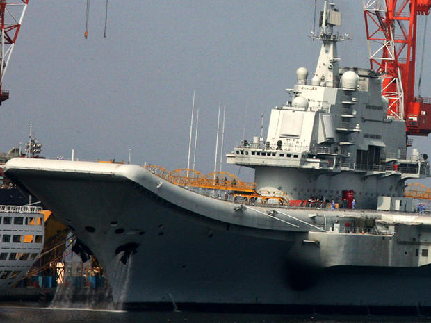 China's first aircraft carrier, the former Soviet carrier Varyag, is seen Aug. 4, 2011, at the Port of Dalian in northeast China's Liaoning Province. The aircraft carrier has begun its inaugural sea trial, the defense ministry said Aug. 10, 2011, a move likely to stoke concerns about the nation's rapid military expansion.