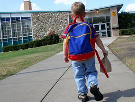 Schoolboy walking up to school