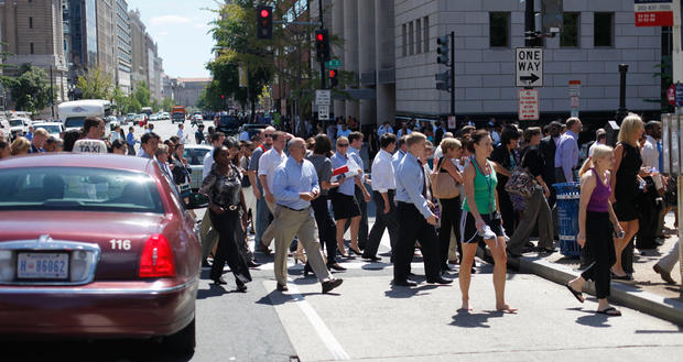 Pedestrians cross an intersection of downtown Washington, Tuesday, Aug. 23, 2011, after office buildings where evacuated following a reported 5.9 earthquake was felt in Washington.