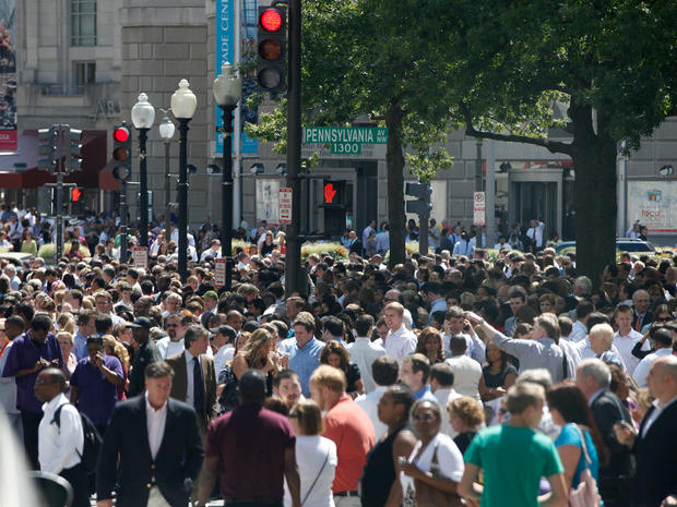 People crowd Pennsylvania Avenue in Washington, Tuesday, Aug. 23, 2011, as they evacuate buildings after an earthquake in the Washington area.