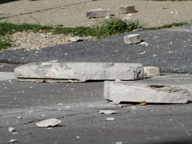 Large pieces of concrete lay in the street in front of the Embassy of Ecuador after the building was damaged in an earthquake.