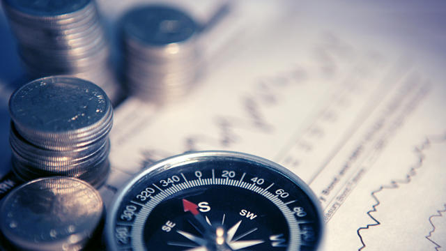 Compass and money on graphs