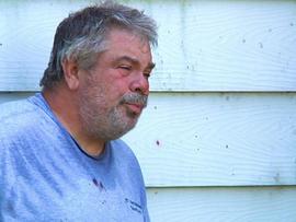 Ken Bargy outside his trailer in Pembroke, Ill.