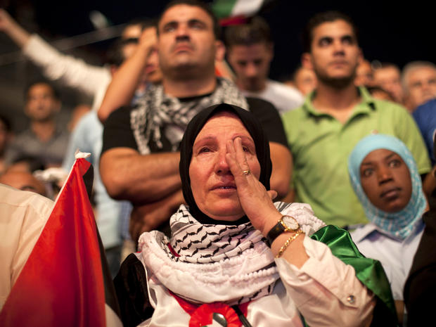 A Palestinian woman cries in the West Bank city of Ramallah as President Mahmoud Abbas addressed the General Assembly of the United Nations Sept. 23, 2011.