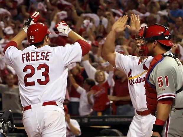 ST LOUIS, MO - OCTOBER 05: David Freese #23 of the St. Louis Cardinals celebrates with teammate Matt Holliday #7 after Freese hits a two-run home run in the sixth inning off pitcher Roy Oswalt #44 of the Philadelphia Phillies in Game Four of the National League Division Series at Busch Stadium on October 5, 2011 in St Louis, Missouri. (Photo by Jamie Squire/Getty Images)