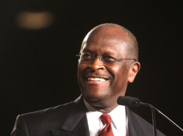 FILE - In this Friday, Sept. 23, 2011 file photo, Republican presidential candidate Herman Cain arrives onstage to address the Conservative Political Action Conference (CPAC) at the Orange County Convention Center in Orlando, Fla. Herman Cain thinks Rick Perry is a good governor, Newt Gingrich is brilliant and Michele Bachmann is a very nice lady. What about Mitt Romney? Nice hair.