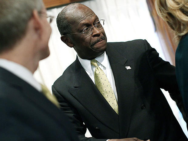 Republican presidential candidate Herman Cain leaves after a speech at the National Press Club October 31, 2011 in Washington, DC.