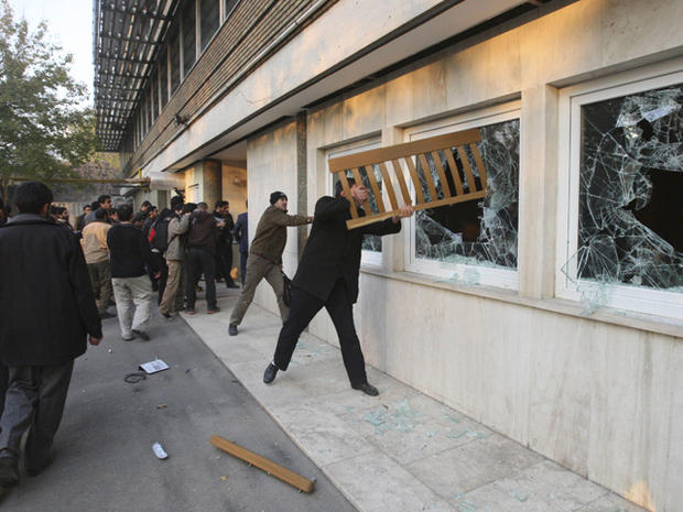 Iranian protesters break the windows of a British Embassy