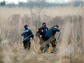 Investigators use metal detectors to search a marsh for the remains of Shannan Gilbert  on Dec. 12, 2011 in Oak Beach, N.Y.