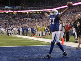 Reggie Wayne exults after his touchdown catch