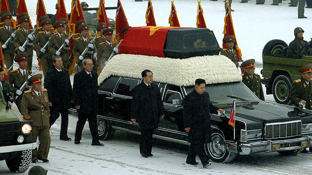 This handout picture taken by North Korea's official Korean Central News Agency (KCNA) on December 28, 2011 shows Kim Jong-Un, center right, and Jang Song-Thaek, center, besides the convoy carrying the body of his father and late leader Kim Jong-Il at Kum