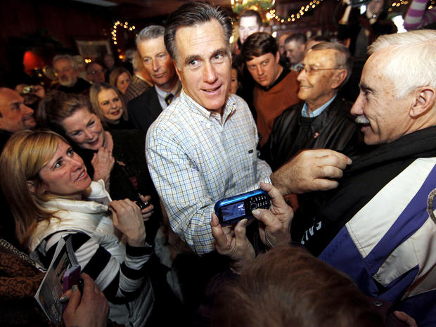 Former Massachusetts Gov. Mitt Romney makes his way through a crowd during a campaign stop at Old Salt Restaurant in Hampton, N.H., Dec. 31, 2011.